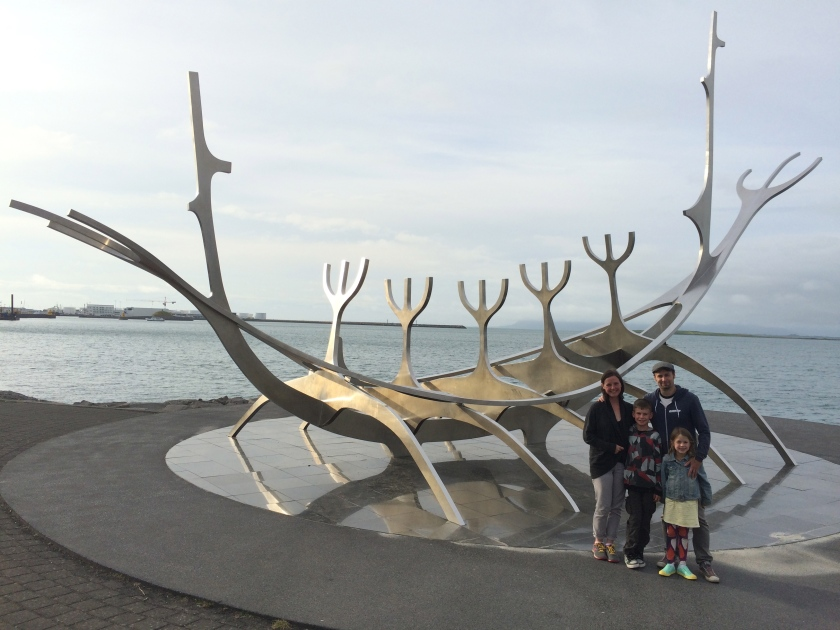 Token family shot in front of the art installation of a Viking ship in Reykjavik harbour.