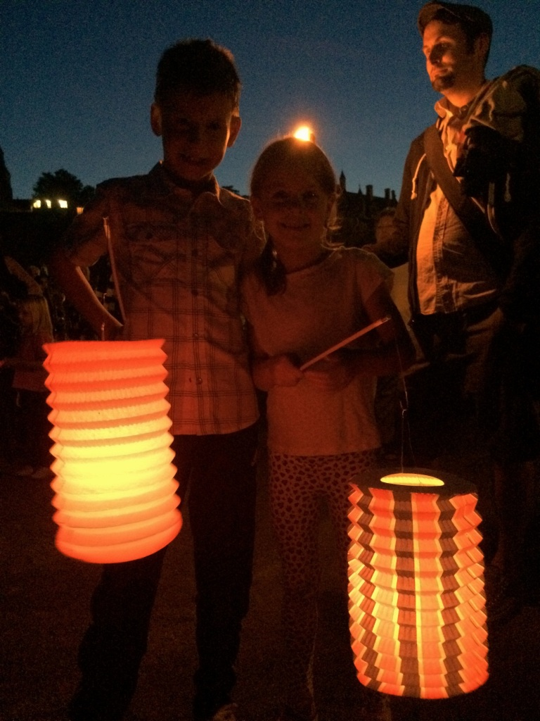 the kids with their torches - real candles! the french really know how to do it up