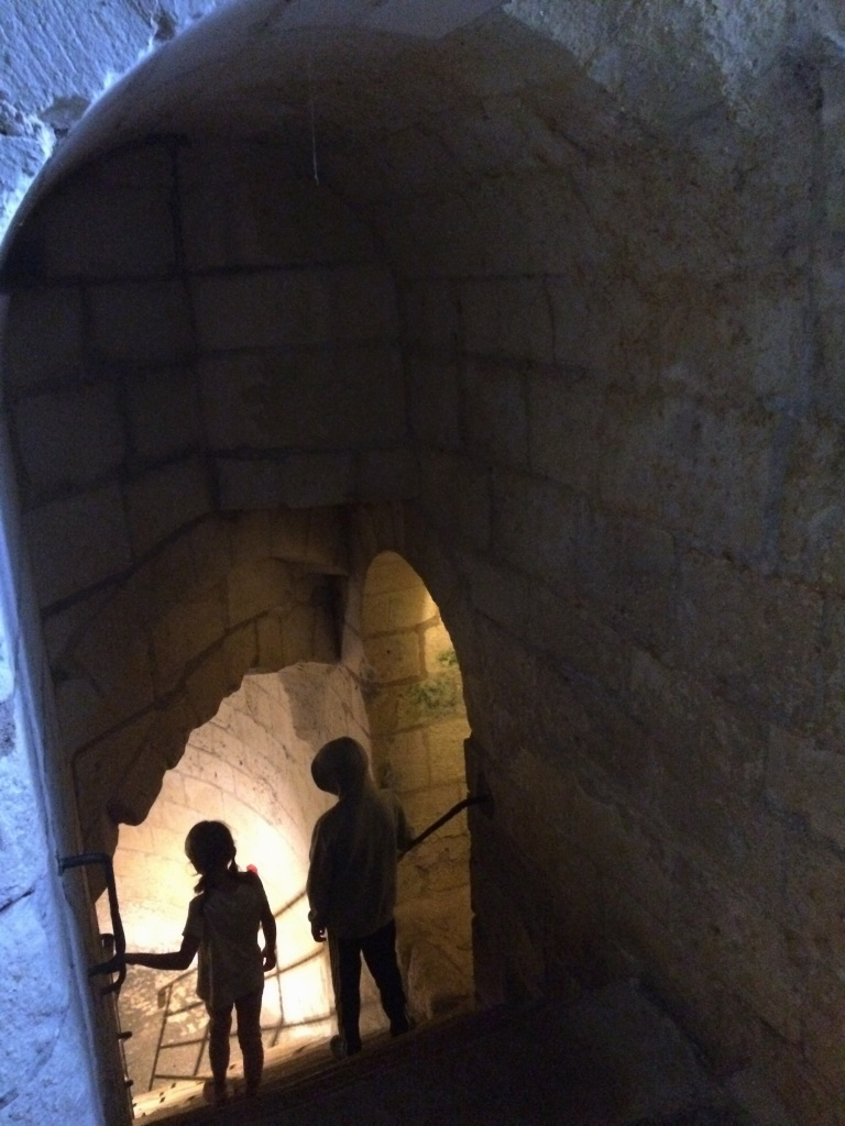 Staircases winding up to the top of the tower and down to the depths of the tunnels below the Martelet.