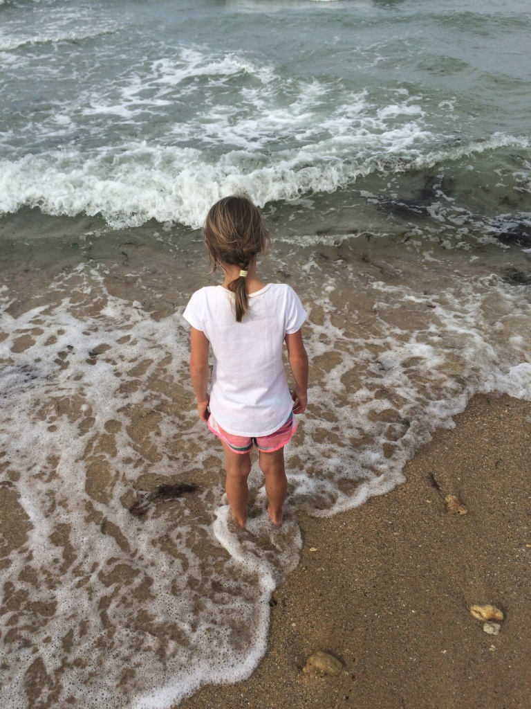 Danica dips her toes in the Atlantic for the first time, at Juno Beach.