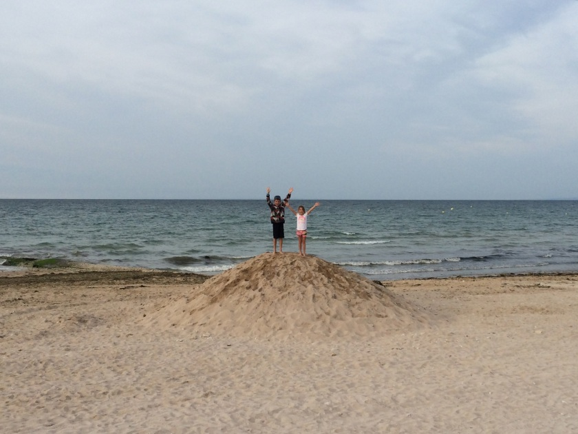 The kids claiming victory at Juno Beach.