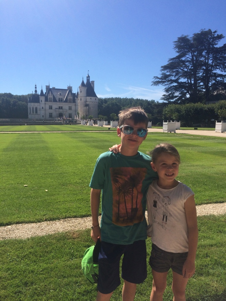 Kiddos in front of the lawns (which of course you can't walk on) on the pathway to Chenonceau