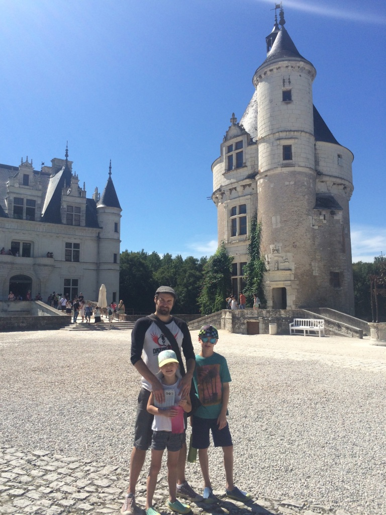 Derek and the kids in the forecourt of the château, with the Marques Tower on the right.