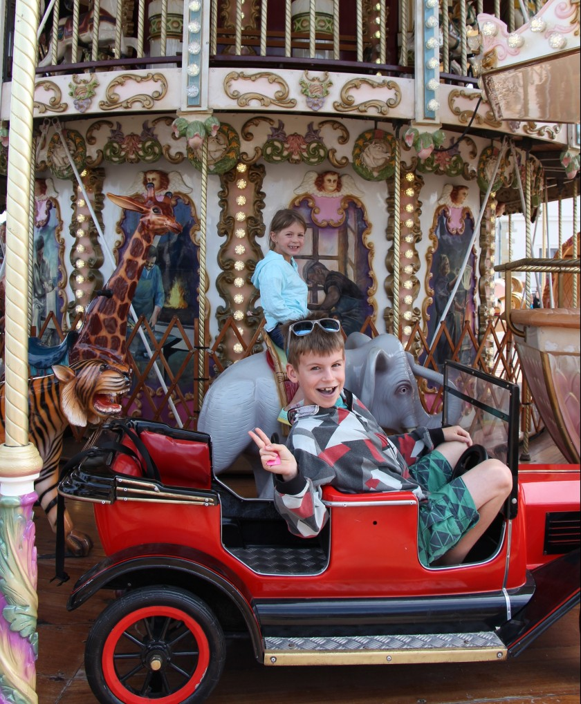 He says he only rode it for the old fashioned car, but I think he really just still loves a beautiful carousel.