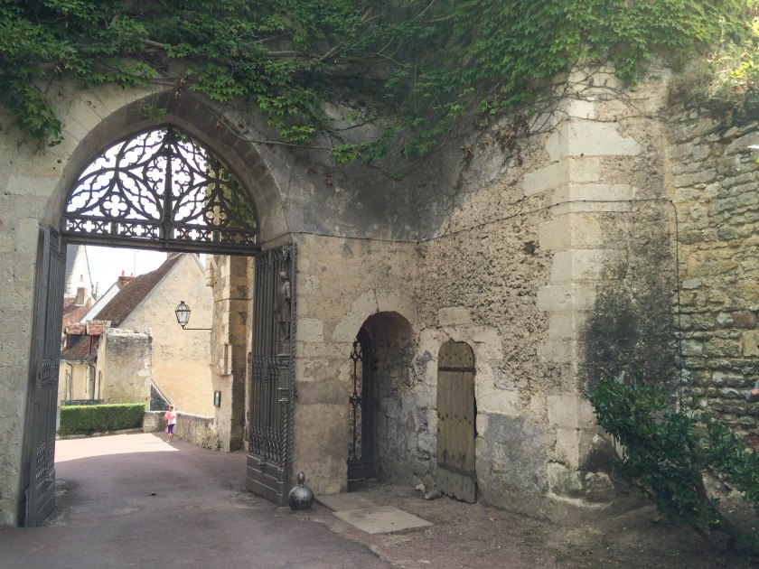 Decorative iron gate shown from inside the Château grounds.