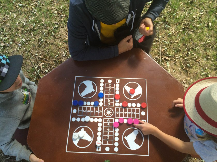Games tables in the park by the river in Montrésor.