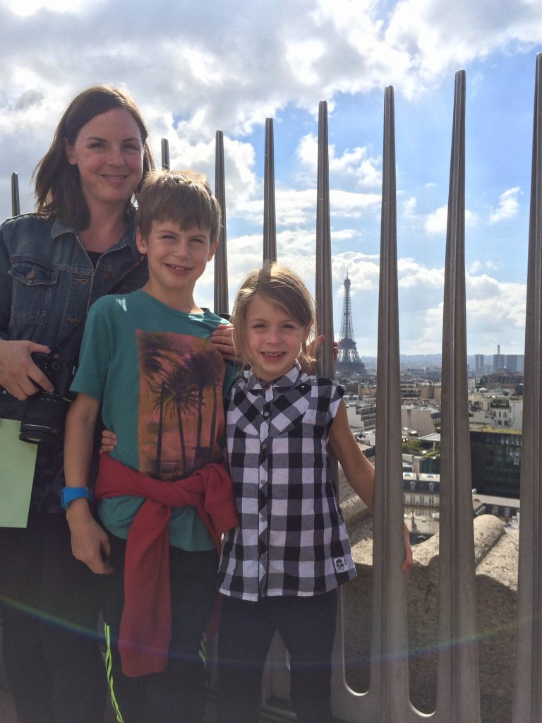 The view from here! On top of l'Arc de Triomphe with the kiddos.