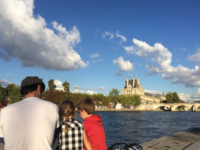 Sitting in the sun on the banks of the Seine, with the Louvre in the background. Every time we walked along the Seine, the kids and I started singing Mamma Mia (much to Derek's delight, obviously!)