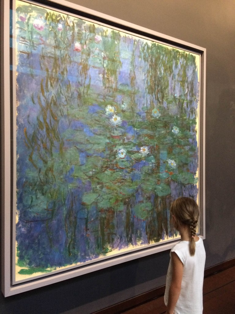 Danica really enjoyed seeing one of Monet's waterlily paintings, after having visited Giverny just a few weeks prior. Next time we're in Paris we will visit l'Orangerie and see his massive waterlilies.