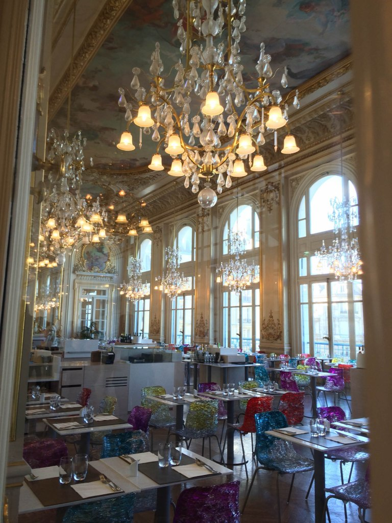 La Musée d'Orsay's beautiful restaurant. Stunning chandeliers, painted ceiling, and ample gold detail. I love the chairs, which look like glass. Perfect museum dining!