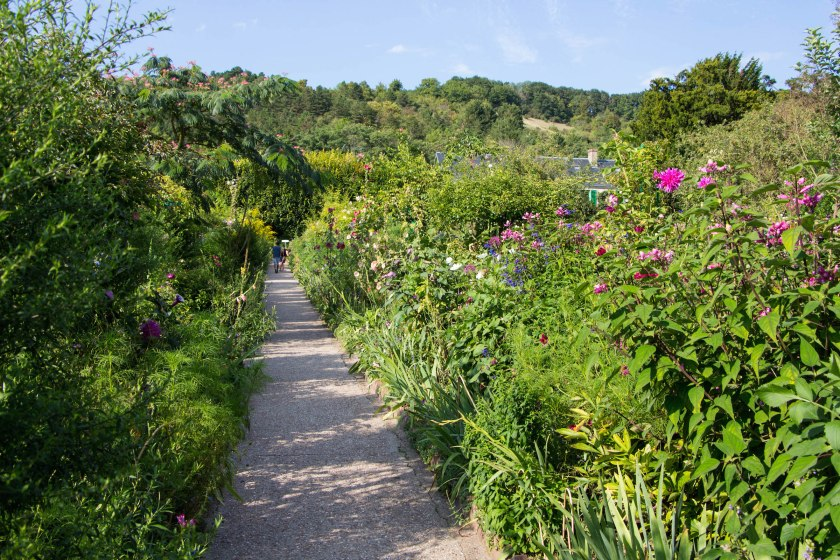 Lush overflowing gardens with Monet's home at the very top.