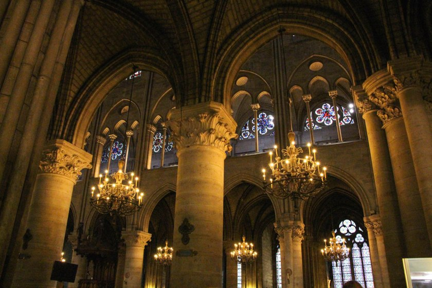 Chandeliers in every archway in Notre Dame. There was a choir singing while we were there - the sound was unbelievable.