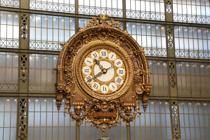 Beautiful golden clock at the head of the grand hall in the d'Orsay.