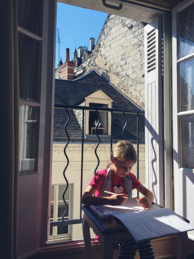 Danica's favourite spot to sit and draw, windows and shutters thrown open, sun on her back, and the tip-tops of the château roof in the background.