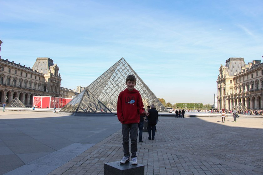 Oliver, so darned excited to be at the Louvre. I feel bad because I didn't realize (and he didn't tell me) that he wanted me to take the photo at the right angle to make it look like he was holding the tip of the pyramid. Oops!