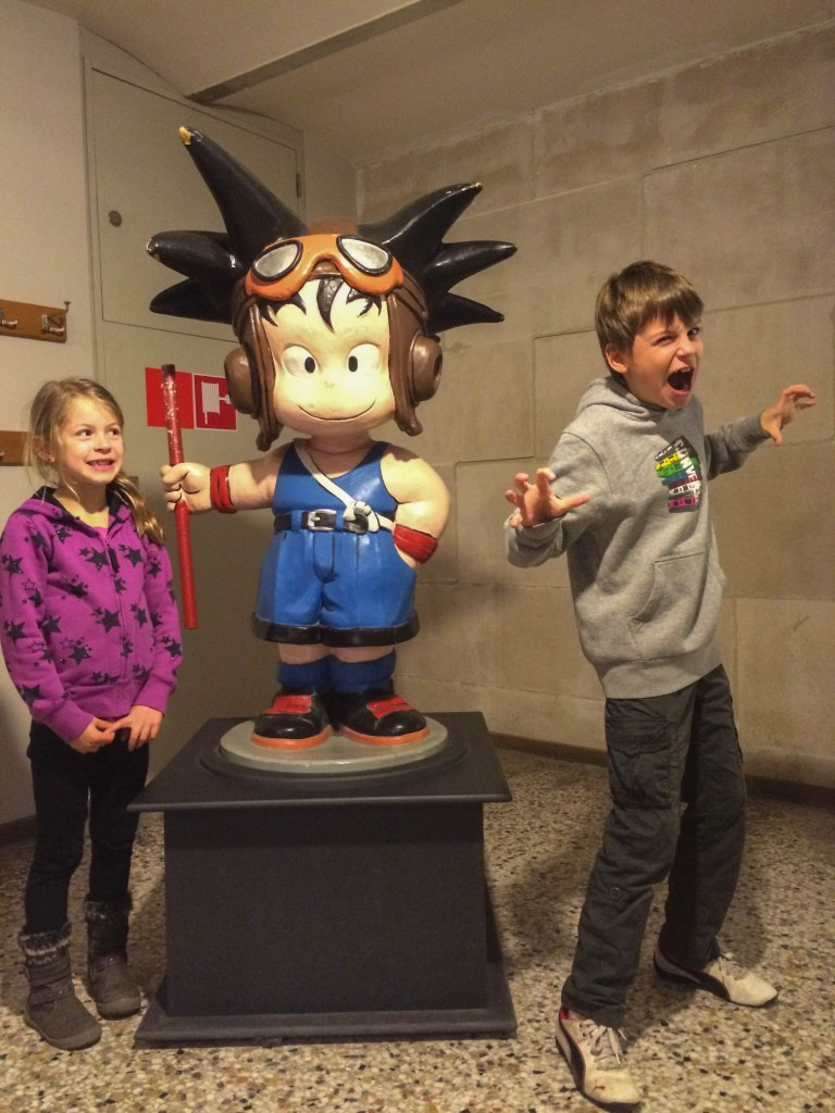 The kids with Goku. This picture cracks me up, Danica's starting to wonder about Oli's poses...
