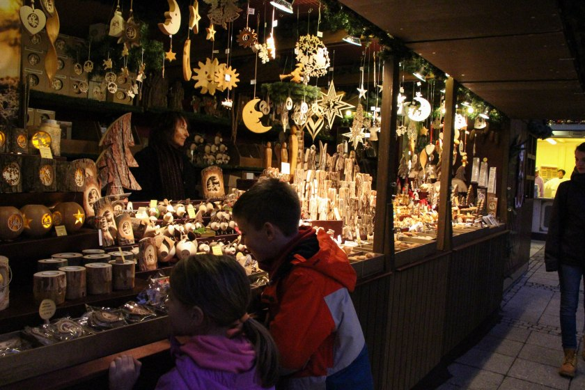 kids and carved wood ornaments