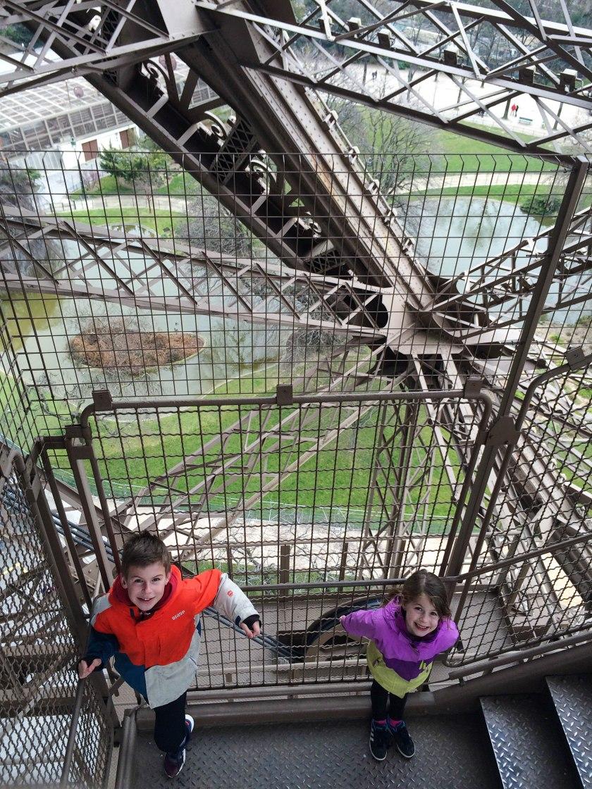 kids climb down eiffel