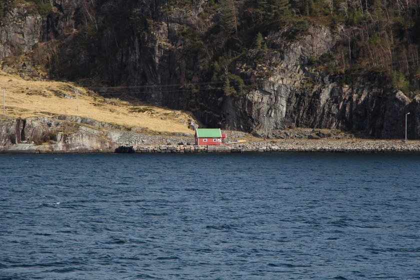 tiny red shack on fjord