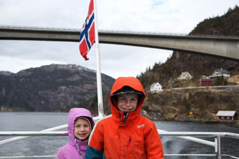 kids and flag on fjord almost home